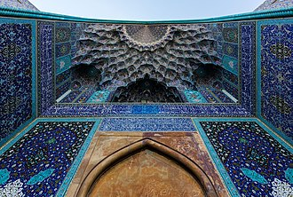 Muqarnas - Decorative muqarnas vaulting in the iwan entrance to the Shah Mosque in Isfahan, Iran
