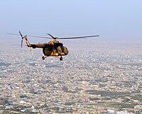 Ми-17 вертолет пролетает над северным афганским городом-101113-N-5006D-582.jpg