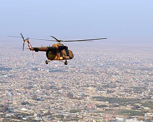 Afghan National Air Force Mi-17 flying over the city