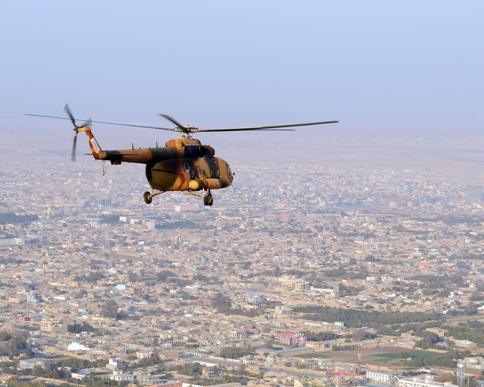 Mi-17 helicopter flies over the northern Afghan city-101113-N-5006D-582