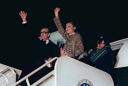 Mohammad Reza Pahlavi, The Shah of Iran, and his wife, Empress Farah, wave goodbye prior to boarding an aircraft after a visit to the United States. Mohammed Reza Pahlavi and his wife.jpg
