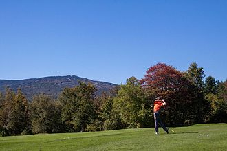 Teeing ground - A local pro tees off at the Mount Snow Golf Club, West Dover, VT, USA
