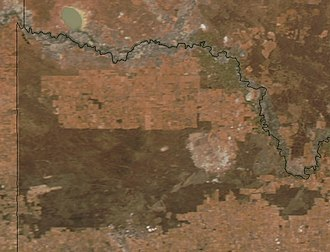 Raak Plain boinka - NASA image. The darker green area to the west and center is the Murray-Sunset National Park. To its east the roughly circular light-colored area is the Raak boinka. East of this is the Hattah-Kulkyne National Park and the Murray River.