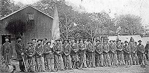 44th Indiana Infantry Regiment - Company H of the 44th Indiana Infantry stands in two-rank order of battle.  Units such as this were rarely at full strength, primarily due to illness. The number of men shown here was typical for a unit in service.