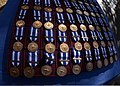 NATO-International Security Assistance Force (ISAF) medals are arranged during a presentation ceremony in Kabul, Afghanistan, Oct. 20, 2013 131117-A-UO630-001.jpg