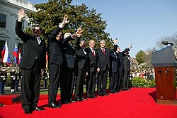 The NATO Secretary General, the U.S. President, and the Prime Ministers of Latvia, Slovenia, Lithuania, Slovakia, Romania, Bulgaria, and Estonia after a ceremony welcoming them into NATO on 29 March 2004 at the Istanbul Summit.