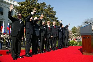 Patria case - President George W. Bush welcoming 7 new states into NATO, March 29, 2004. From left are: Prime Minister Indulis Emsis of Latvia, Prime Minister Anton Rop of Slovenia, Prime Minister Algirdas Brazauskas of Lithuania, Prime Minister Mikulas Dzurinda of Slovakia, President George Bush, Prime Minister Adrian Năstase of Romania, Prime Minister Simeon Saxe-Coburg Gotha of Bulgaria, Prime Minister Juhan Parts of Estonia, and NATO Secretary General Jaap de Hoop Scheffer.
