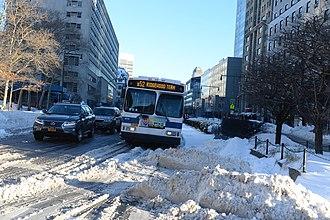 Greene and Gates Avenues Line - A Ridgewood-bound B52 bus in Downtown Brooklyn.