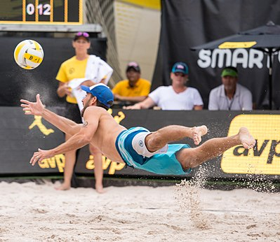 "Unlike indoor volleyball, beach volleyball is played on soft sand which makes it safer for players to dive. Picture shows Nick Lucena of the United States diving to ""dig"" the ball. Nick Lucena at the AVP Austin Open 2017 (4).jpg"