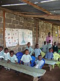 Nursery school class with teacher (5792209251).jpg