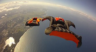 Wingsuit flying - Wingsuit formation flight over a coast