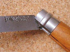 Opinel knife - The same knife with locking ring released in order to close the blade