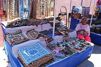 Otomi - Otomi woman selling traditional Otomi embroidered cloths in Tequisquiapan