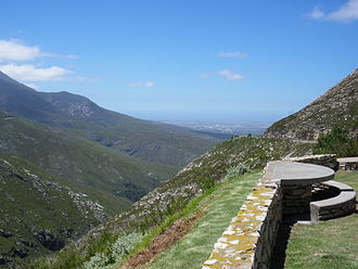 Scenic viewpoint - Scenic overlook in the Outeniqua Pass, South Africa, over George and the Indian Ocean. Parking and picnic tables are provided next to the road.