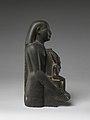 Padiamunrenebwaset, son of Irethoreru, holding a seated statue of Osiris MET DP245121.jpg