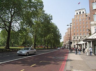 Park Lane - Looking north on Park Lane. Hyde Park is to the left; the Grosvenor House Hotel to the right.