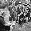 Pay Day for Boy Scouts at a fruit-picking camp near Cambridge in 1943. D16223.jpg