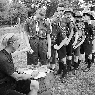 Allowance (money) - Image: Pay Day for Boy Scouts at a fruit picking camp near Cambridge in 1943. D16223