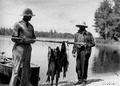 Photograph of Two Fishermen and Their Catch of Northern and Wall-Eyed Pike - NARA - 2128776.tif