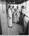 Photograph taken during the vacation cruise of President Harry S. Truman to Bermuda. President Truman (in bathrobe)... - NARA - 198645.tif