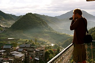 Banaue Rice Terraces - A tourist taking a photograph of the rice terraces.