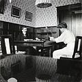 Pierre Gilliard and Olga Nikolaevna in the schoolroom.jpg