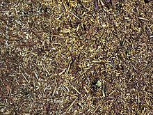 Pine wood chips at Hatfield Broad Oak, Essex, England.jpg