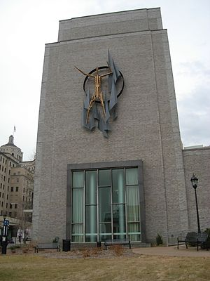 """Parran Hall - The """"Man"""" sculpture by Virgil Cantini on the facade of Parran Hall."""