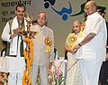 Pranab Mukherjee lighting the lamp to inaugurate the 16th Indian Cooperative Congress, in New Delhi. The Union Minister for Agriculture and Food Processing Industries, Shri Sharad Pawar and the Chief Minister of Delhi.jpg