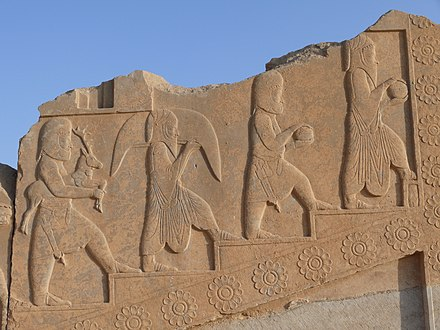 Arachosian priests of Zoroastrianism carrying various gifts and animals for a ritual of sacrifice at Persepolis