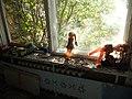 Pripyat; windowsill with dolls and tin toy trucks.jpg