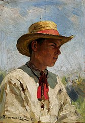 A boy in a straw hat.