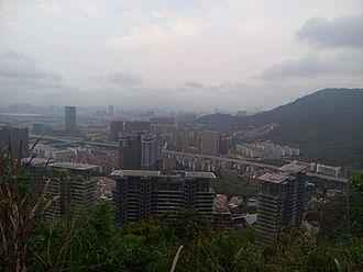 Nanshan Mountains (Shenzhen) - Qianhai and Dananshan (right) as viewed from Xiaonanshan
