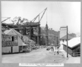 Queensland State Archives 3593 Main bridge erection stage 1 cross girder at A1 being placed on timber trestles Brisbane 15 September 1937.png