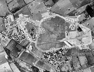 RAF Honington - Aerial photography of RAF Honington, 25 January 1944 oriented north. The pre-World War II Honington Airfield is on the right, the 1st Strategic Air Depot is to the left. Note the large number of B-17 Flying Fortress aircraft parked on numerous hardstands at both the airfield and depot