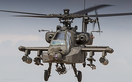 AH-64 Apache in flight RNLAF AH-64 Apache at the Oirschotse Heide Low Flying Area (36570605232).jpg