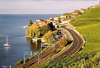 Rivaz - Rivaz village with train tracks and road