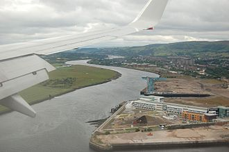 John Brown & Company - Site of the former John Brown Shipyard in 2007, with the old Titan Crane and fitting-out basin. The new Clydebank College campus is in the foreground, straddling the slipways of the old East Yard.