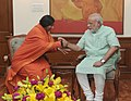 Sadhvi Rithambara tying 'Rakhi' to the Prime Minister, Shri Narendra Modi, on the occasion of 'Raksha Bandhan', in New Delhi on August 10, 2014.jpg