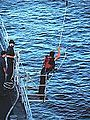 Sailor from USS Arthur W. Radford (DD-968) takes channel sounding with a lead line c1981.jpg