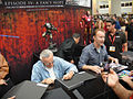 San Diego Comic-Con 2011 - Stan Lee and Morgan Spurlock sign the Episode IV- A Fan's Hope book for fans (Sideshow Collectibles booth) (5976449073).jpg