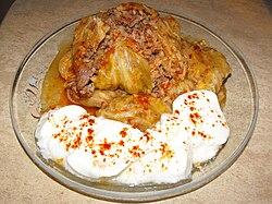 Bulgarian sarma with minced meat, rice, and yogurt.