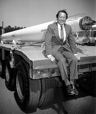 Brookhaven National Laboratory - Satoshi Ozaki posed with a magnet for the Relativistic Heavy Ion Collider in 1991