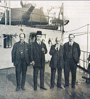 Damat Ferid Pasha - Damad Ferid Pasha (wearing the fez) with the three other signatories of the Treaty of Sèvres; to his right, Rıza Tevfik, and to his left, the Ottoman minister of education Bağdatlı Hadi Pasha and the ambassador Reşad Halis; on board an Allied warship taking them to the Paris Peace Conference. All four would be stripped of their citizenship by the Turkish Grand National Assembly during the week of the treaty's signature and would head the list of 150 persona non grata of Turkey after the Turkish War of Independence.