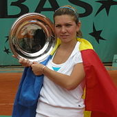 Halep posing with the French Open trophy