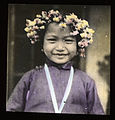 Smiling girl wearing a floral head wreath, China, ca. 1918-1938 (MFB-LS0234).jpg