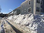 Snowplows bury cars after blizzard of 2015.JPG