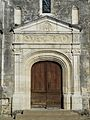 Sorges église portail collatéral.JPG