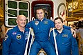 Soyuz TMA-20M crew in front of their spacecraft.jpg