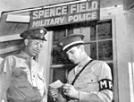 Spence Army Airfield -MP checking Cadets AGO Card.jpg